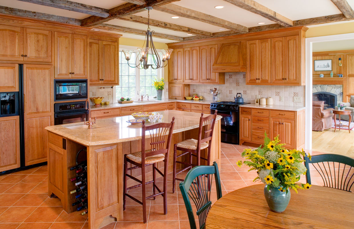 large kitchen with all wood accents and an island