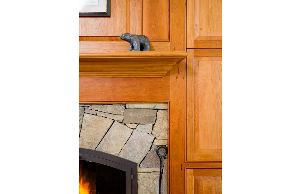 detail of wood molding around a fireplace