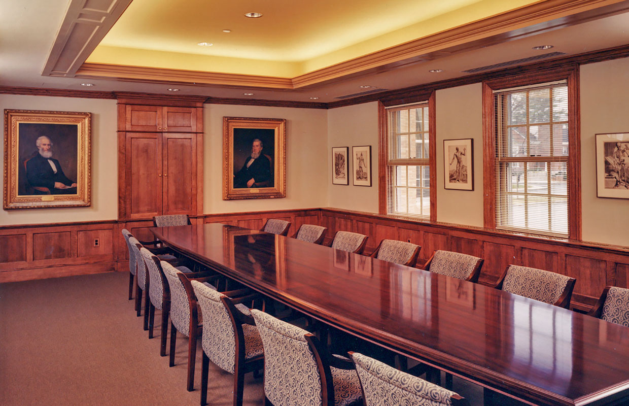 board room with a long wooden table and chairs
