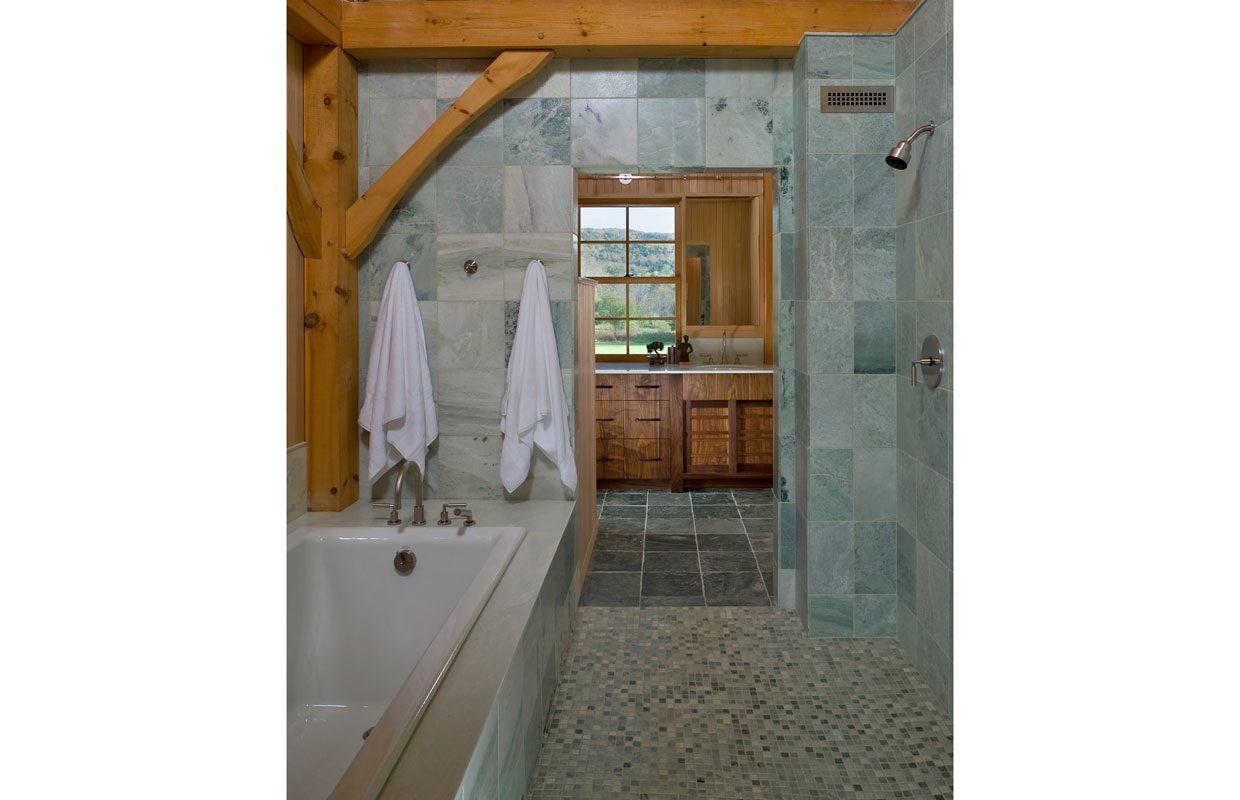 tile shower room with a tub
