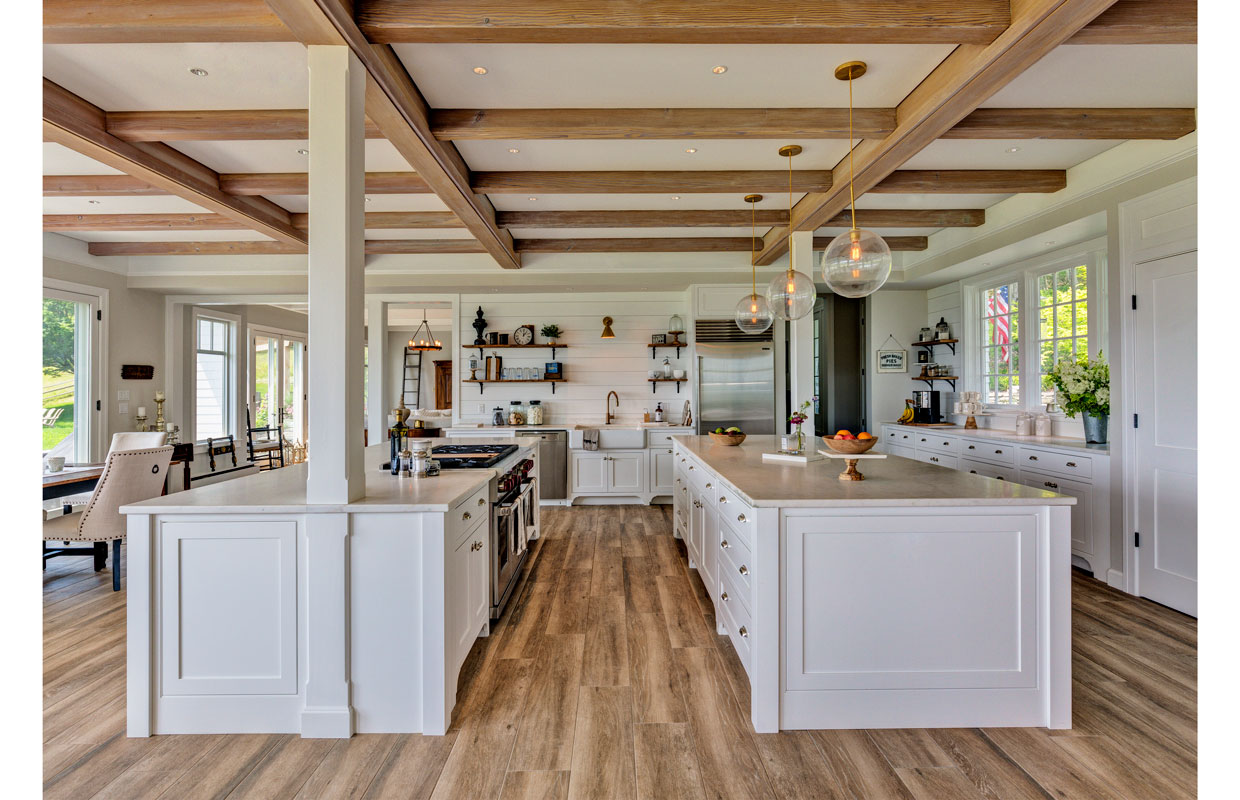 large white kitchen with exposed wood beams on the ceiling