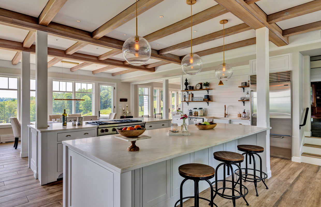 large kitchen with wrap around windows, exposed beams and lots of light