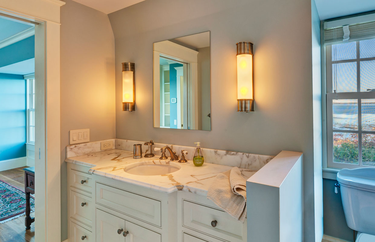 white wooden vanity in a bathroom