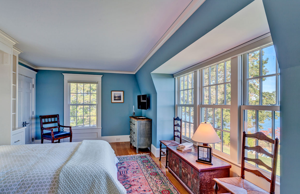 bedroom with a large wall of windows and blue walls