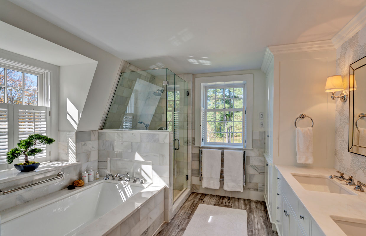 large white bathroom with a tub