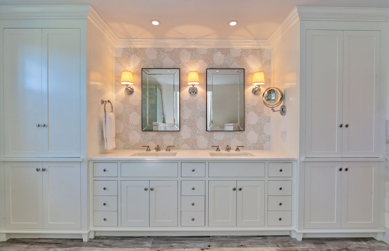 his and hers sinks on a wall with white cabinets