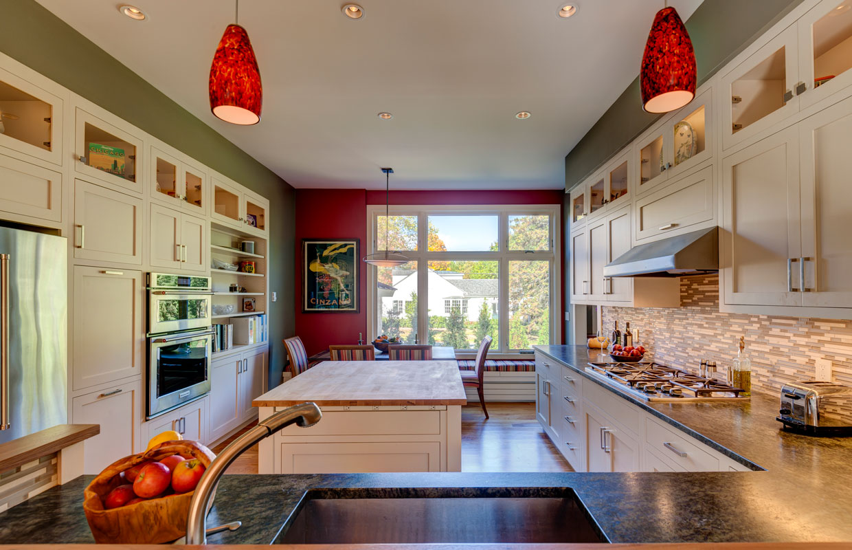 large kitchen with red accents, view from the sink