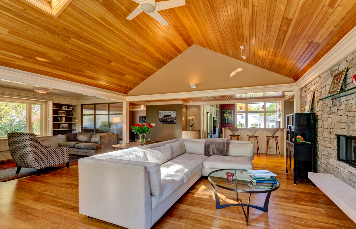great room with a-frame ceiling and hardwood floors