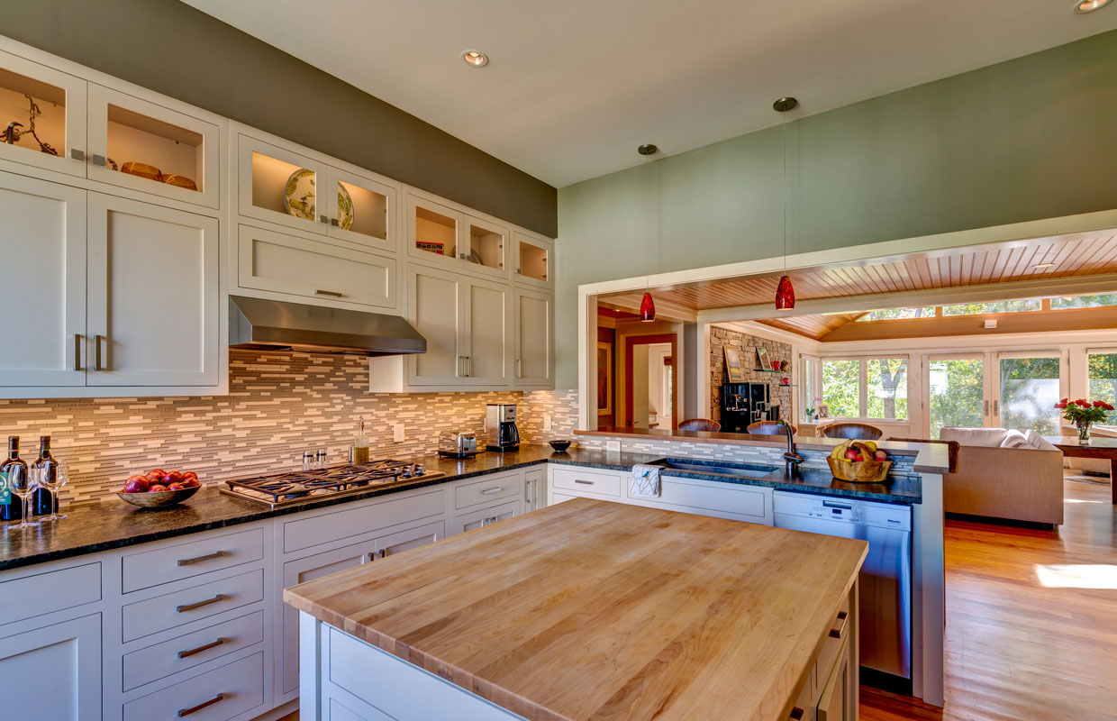 kitchen with tile backsplash and green walls