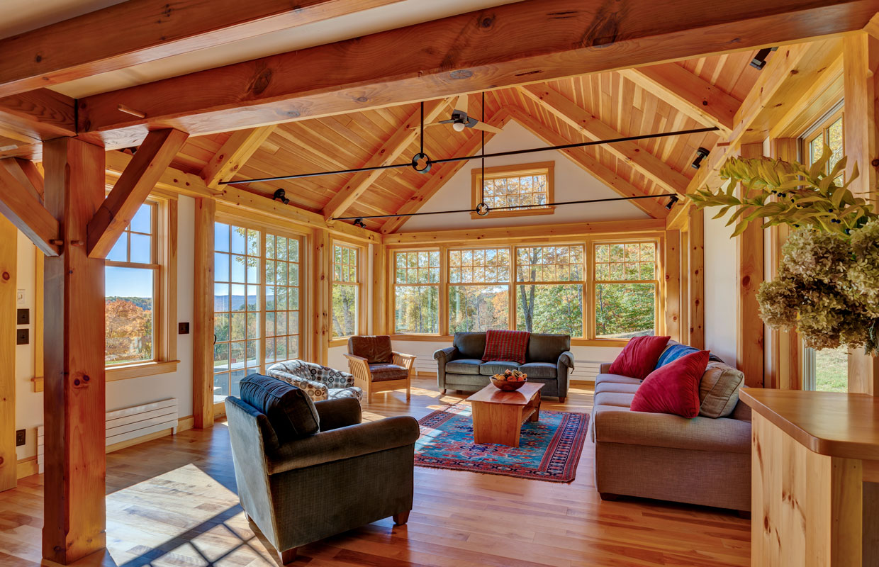 timber-framed sun room with couches