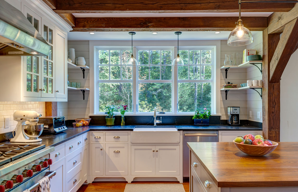 large kitchen with wood island and exposed beams