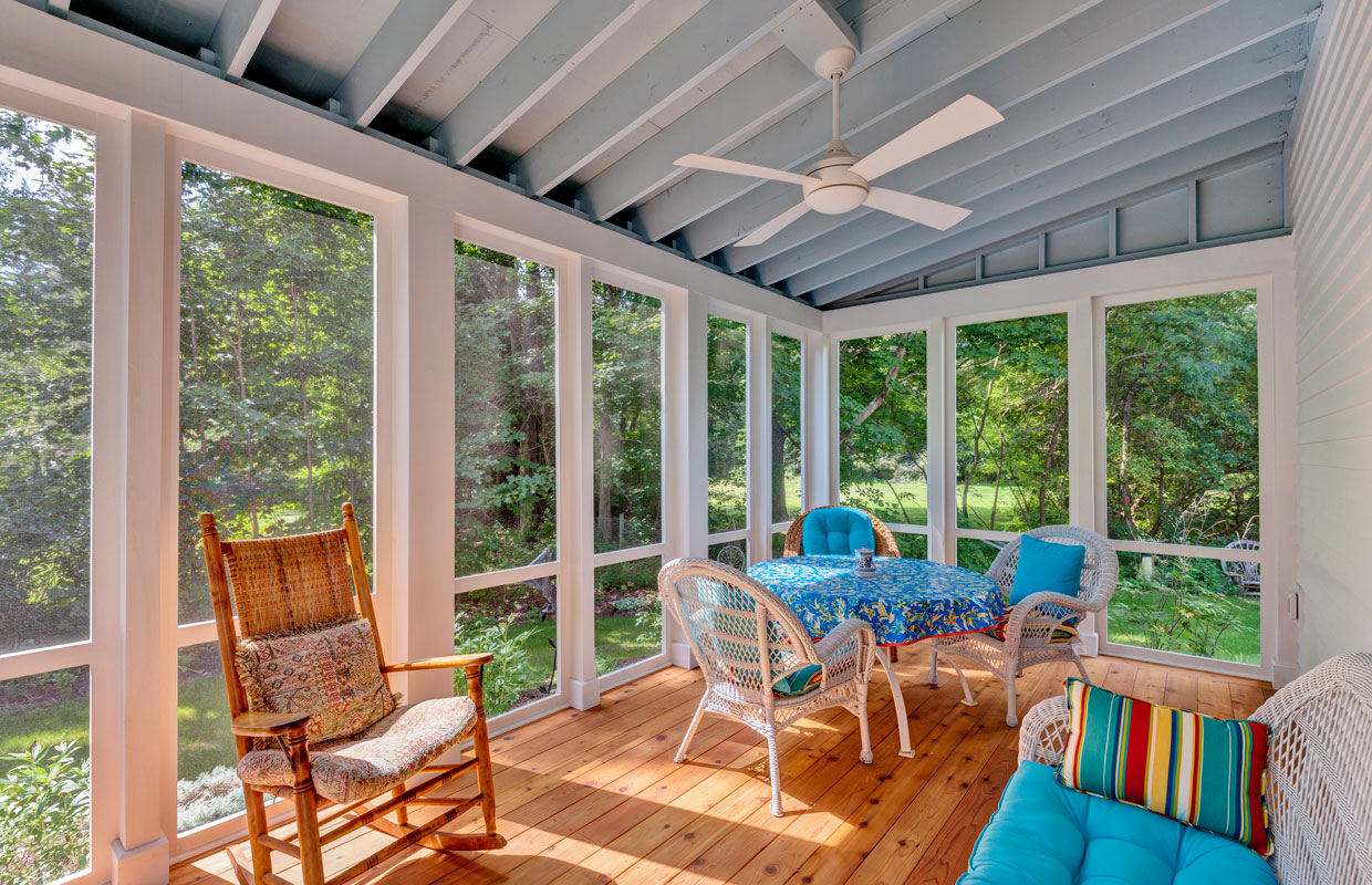 3 season porch view from the inside with a ceiling fan