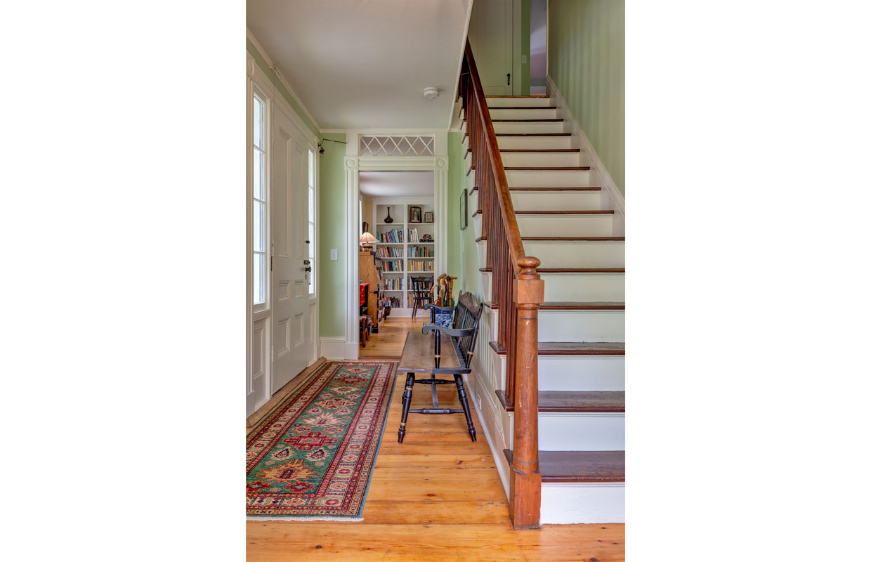 staircase with hallway to the left