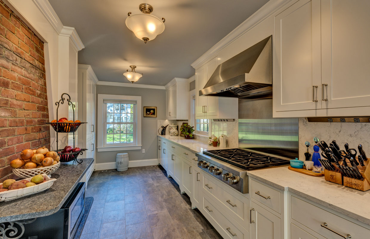 large kitchen with fruit on the counter