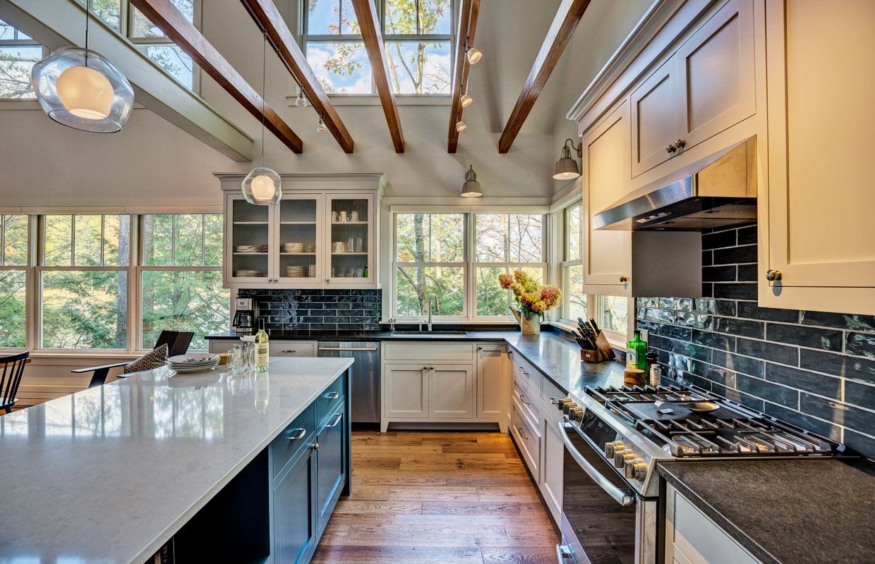 large kitchen with ceiling beams and a white island
