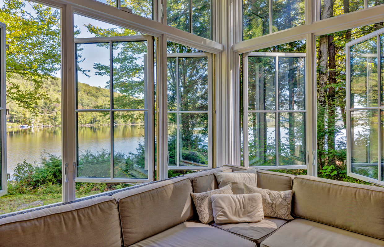 large windows open with a lake view outside