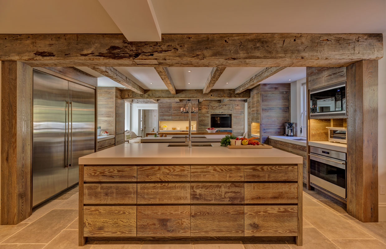 large kitchen with a massive stainless steel refrigerator and island