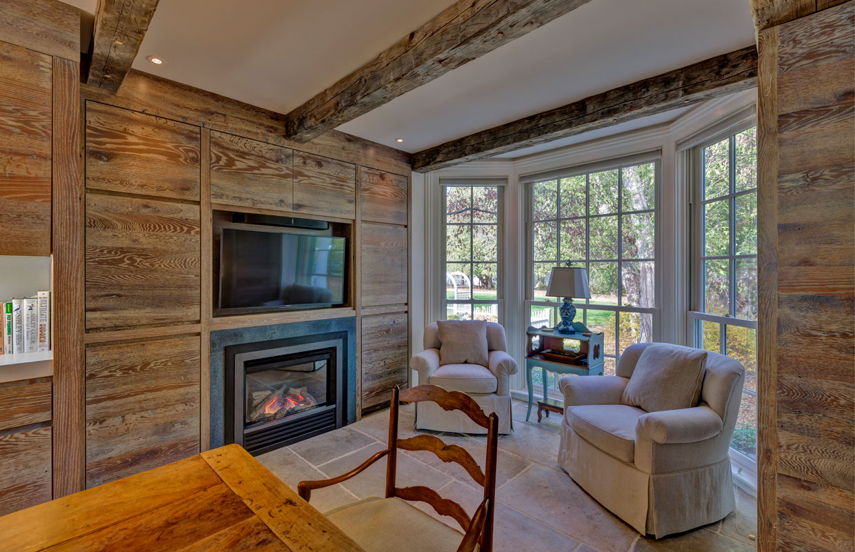 fireplace on a wall with weathered wood accents