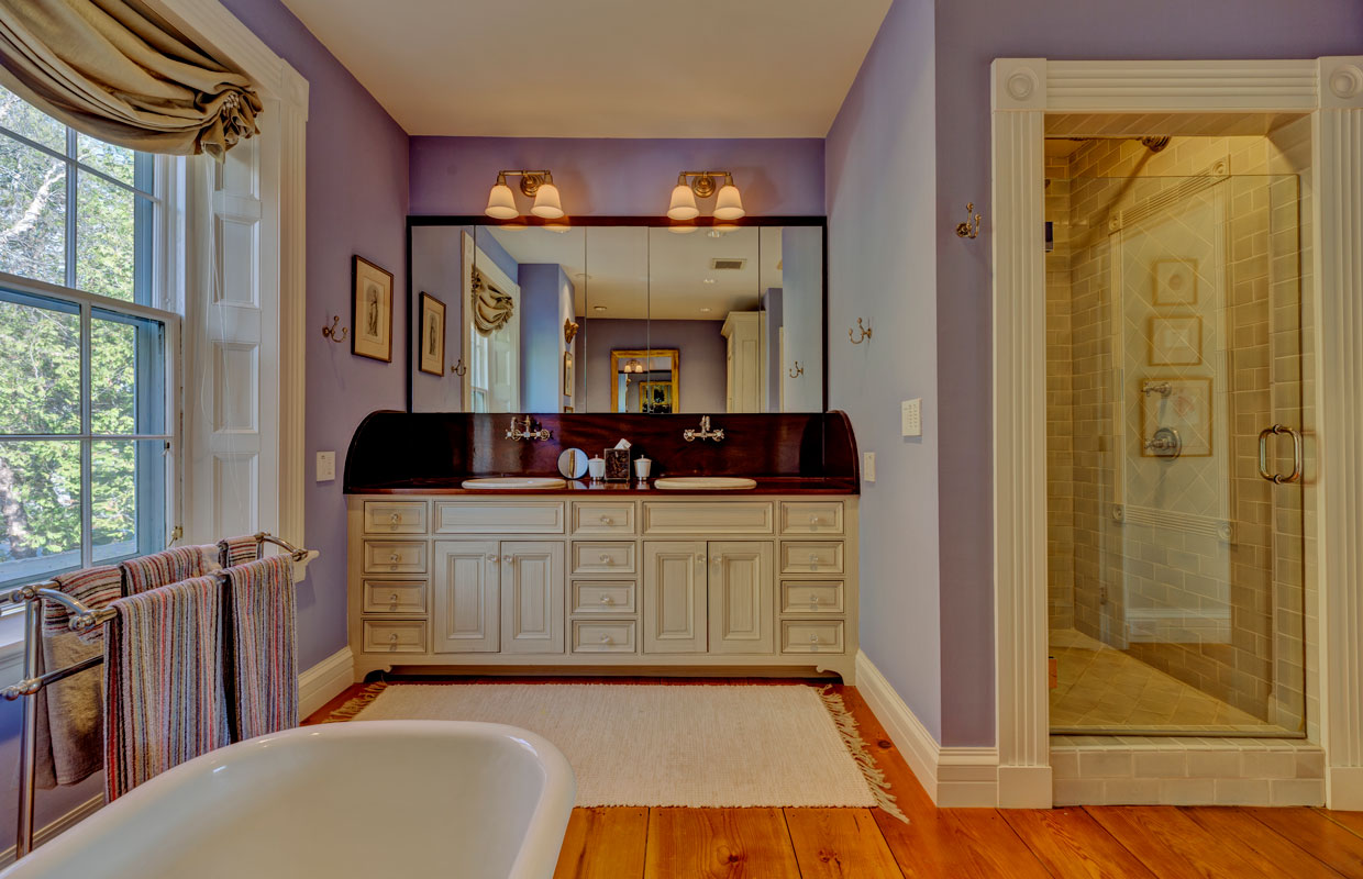 large white vanity in a purple bathroom