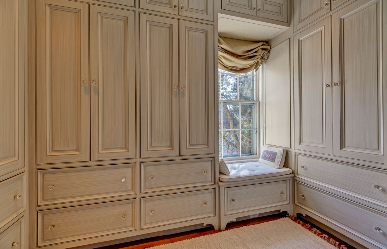 detail view of a weathered white cabinet in a bedroom