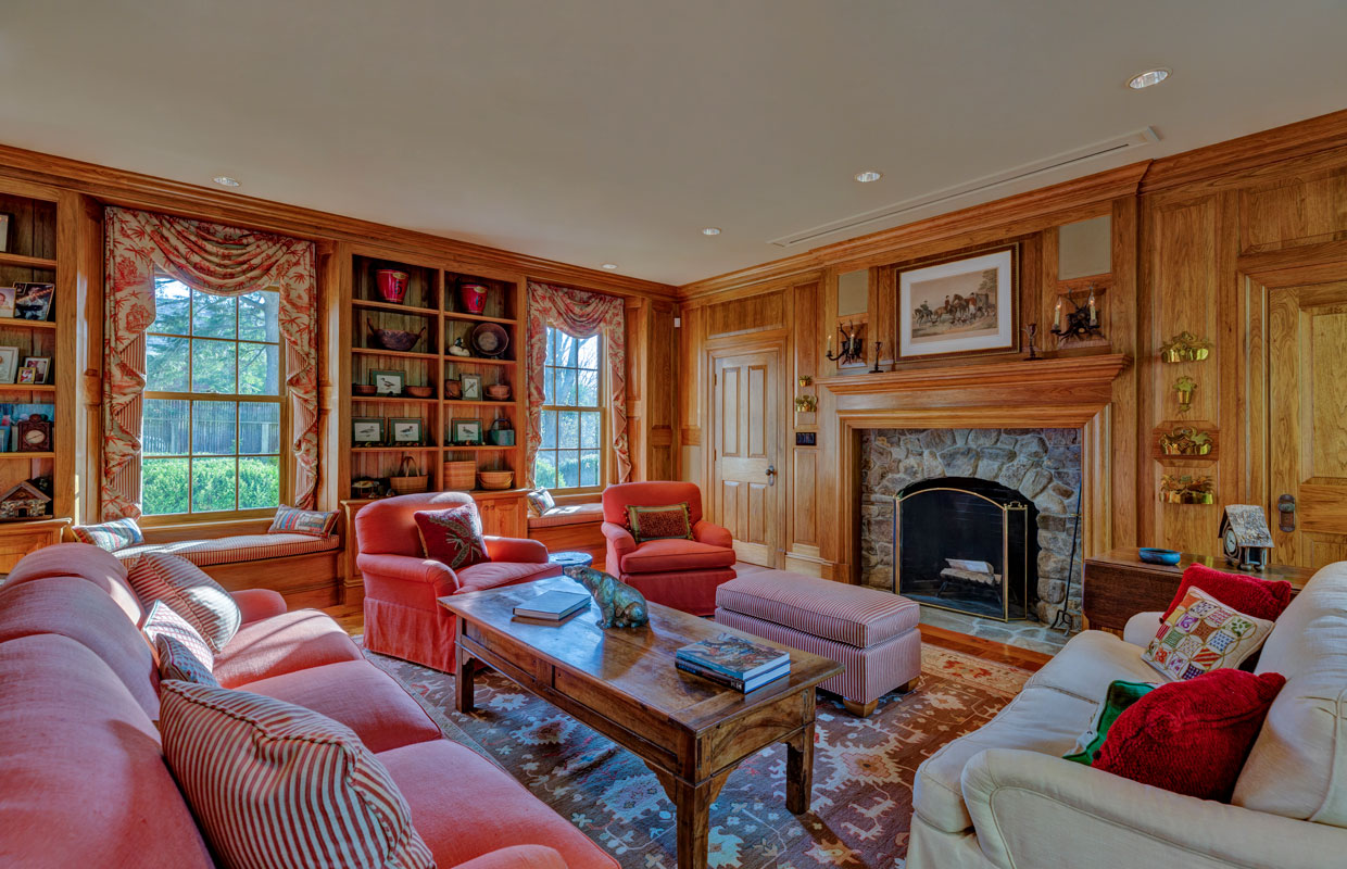 library in a home with a stone fireplace