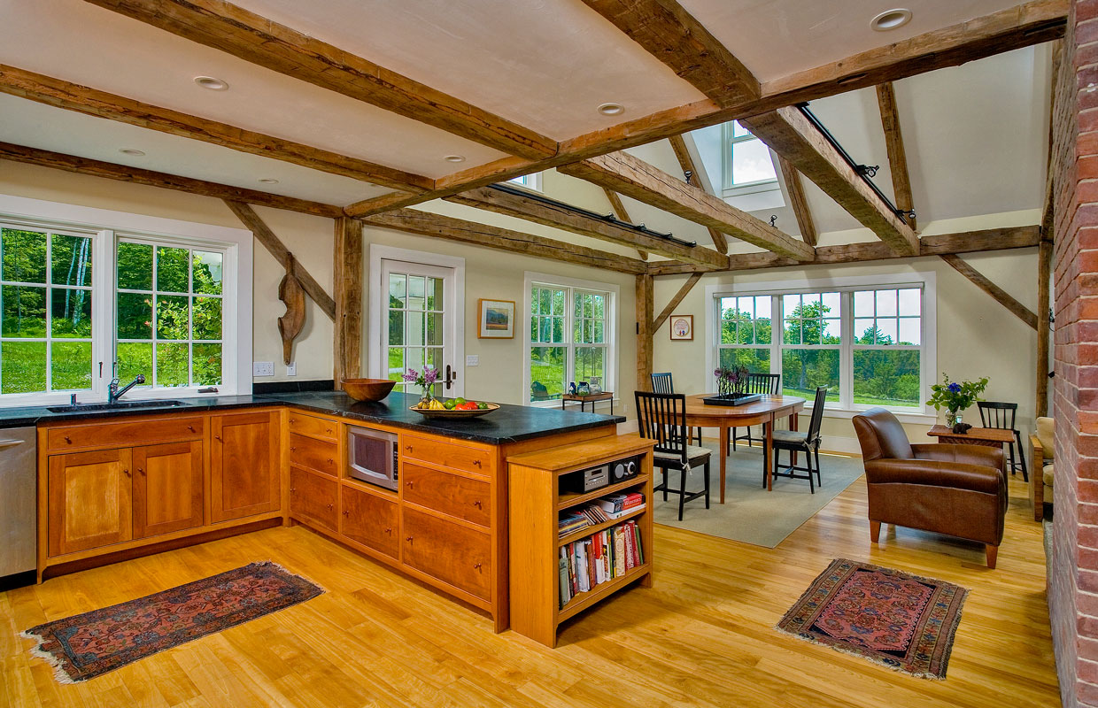great room with wood floors and exposed beams