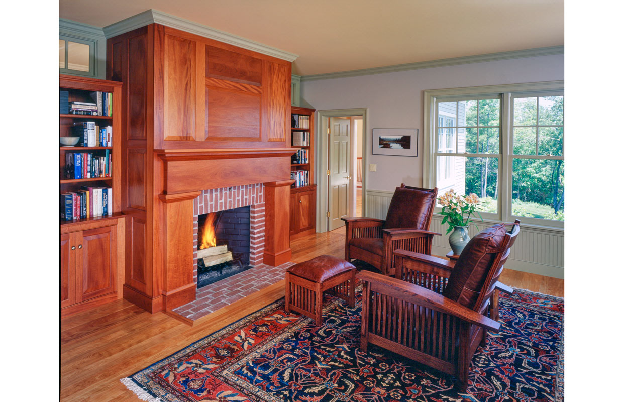 sitting room with a fireplace trimmed in wood