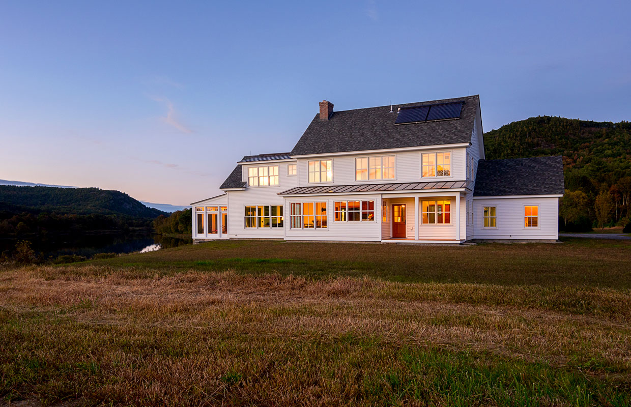 white farmhouse in a field