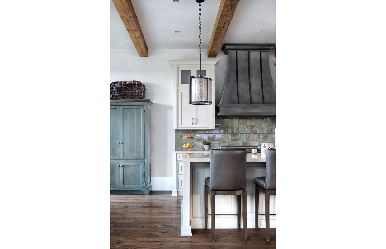 farmer's kitchen with rustic cabinets and high top chairs