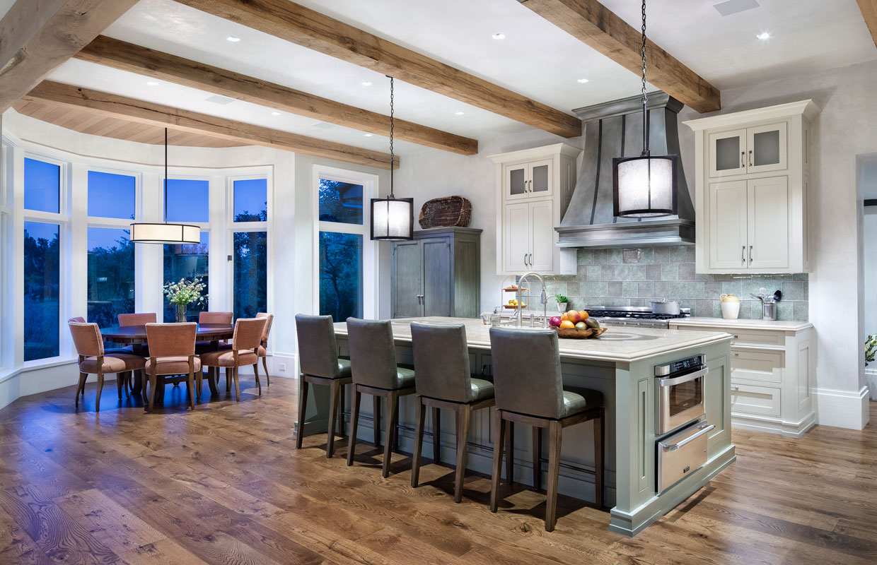 kitchen and dining room of a large home with exposed beams