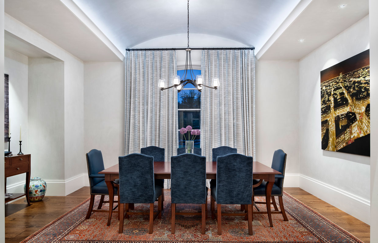 formal dining room with large windows and floor to ceiling drapes