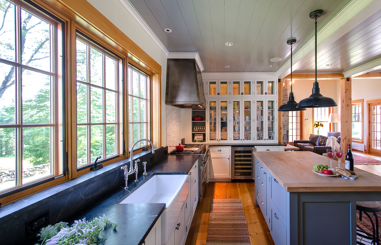 large kitchen with stone countertops and a wood island