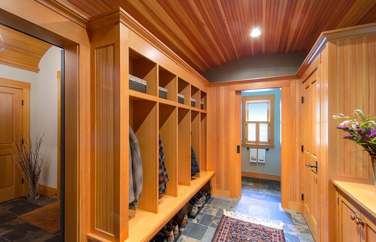 mudroom with cubbies for clothes and boots