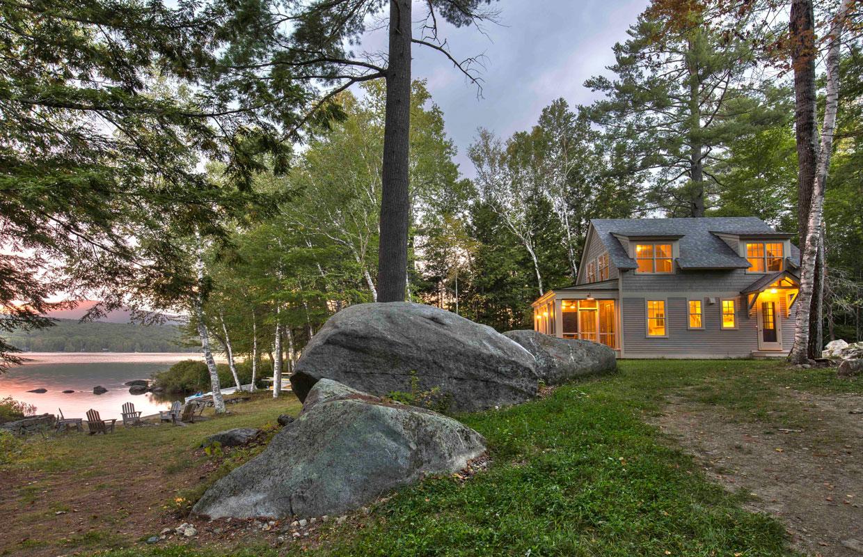 lakeside home at dusk
