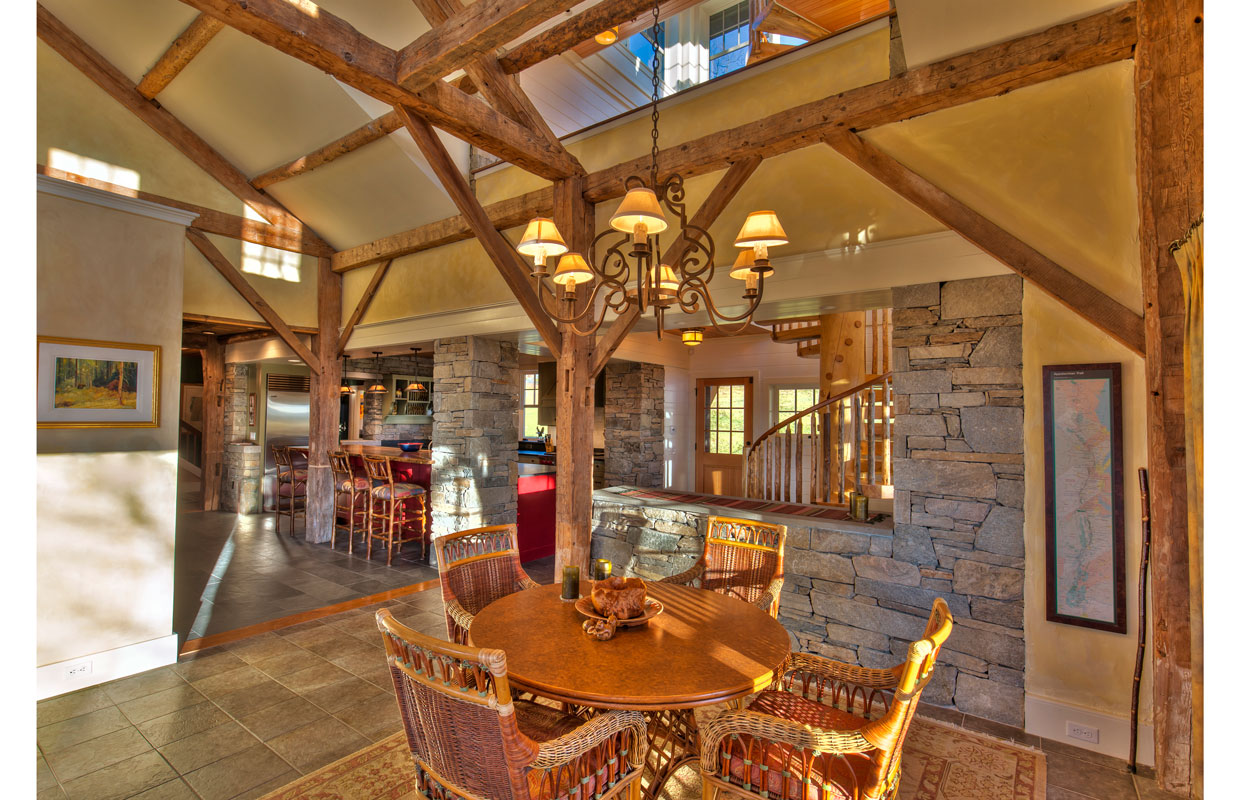 great room with lots of stone accents