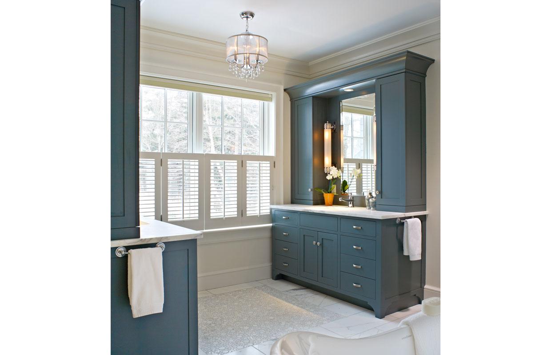 dark greenish blue vanity in a bathroom