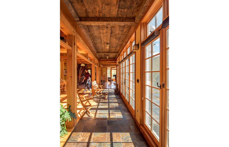 long corridor of windows and a tile floor