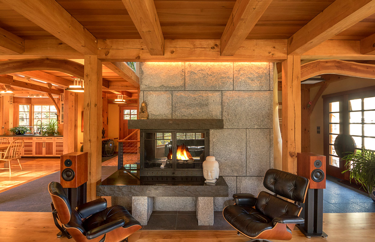 stone fireplace and leather chairs with an in-house sound system